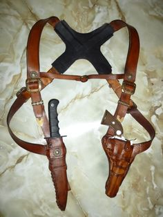 Pistol Harness- UNCHARTED - Mountain Man -Leather Pistol Harness- UNCHARTED - Mountain Man - Custom made leather shoulder holster and by desertwaveleather Gun holster underarm Leather Apron, Sewing Leather, Leather Craft, Leather Men, Nathan Drake, Knife Holster, Western Holsters, Leather Holster, Leather Bracers
