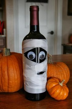 Halloween Mummy Decorations with Tutorials — mummy wine bottle