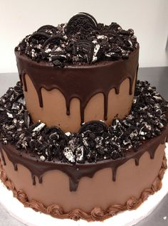 chocolate grooms cake--maybe w/crushed PB cups instead of Oreos.  Love the dripping ganache.