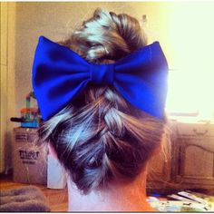 French braid starting from the nape of the neck and tie the rest of the hair into a bun. Add bow :) I did it in 10 minutes!