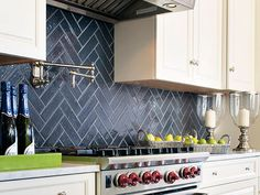 Herringbone tile is timeless. See all of 2015's top kitchen backsplash ideas here >> http://blog.diynetwork.com/maderemade/2015/08/11/kitchen-backsplash-ideas-2015/?soc=pinterest