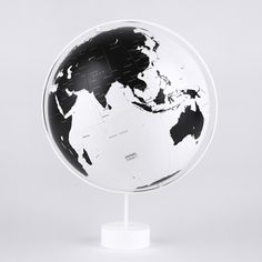 globes depicting white oceans and black land masses