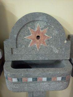Fountain in peperino,volcanic stone.Red star in marble red Verona.(by Rustici del Trusco-Italy) eshop.ciottoli.it