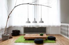 tree branch with pendant lights