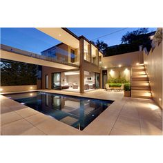 R: like the lighting especially for the stairs, Open outdoor entertainment area, modern yet still classic, sandstones and glass