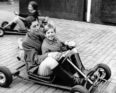 Full speed ahead: Charles, The Prince of Wales gives his little brother Prince Edward, five, a go-kart ride in 1969. ~ Photo by Gamma-Keystone via Getty Images.