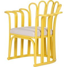 Calla Accent Chair, Canary Yellow -- Breezy and whimsical, the beautifully contoured frame on this bright yellow accent chair takes inspiration from the calla lily. Carefully crafted with sturdy rattan and a generously padded seat cushion.
