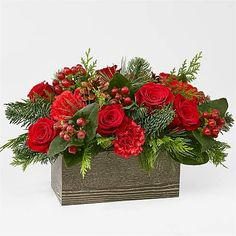 Inspired by the rustic charm that comes with the holiday season, elevate your décor with an array of fresh red blooms and greenery. Christmas Plants, Christmas Flowers, Winter Flowers, Christmas Diy, Christmas Wreaths, Christmas Tables, Winter Floral Arrangements, Christmas Flower Arrangements, Christmas Centerpieces