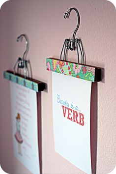 Wooden hangers covered in scrapbook paper and used to hold art