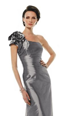 One-shoulder mermaid dress with asymmetrical neckline. Beautiful single short sleeve accented with dramatic hand-crafted floral detail and pleating.