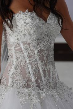 Beautiful fitted corset top wedding gown with a sweetheart neckline, plenty of bling, and see-through bodice