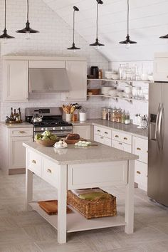 10 Gorgeous Kitchens To Inspire A Remodel #refinery29  http://www.refinery29.com/kitchen-design-ideas#slide-5  —SPONSORED— Give your kitchen a cool, modernized bistro feel with charming touches like stylized cabinets with old-school hardware, vintage-style light fixtures, and tiled walls. Need a little help? Perfect timing. The experts at Home Depot have rolled out My Kitchen Planner, a consultation service to give your cooking quarters that much-wanted facelift. Now you can replace, reface…
