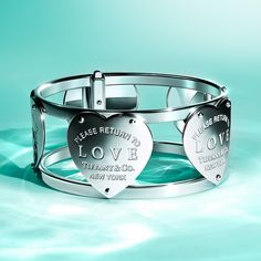 You're sure to love our Return to Tiffany® wide hinged cuff in sterling silver, a bold finishing touch to any festive ensemble.