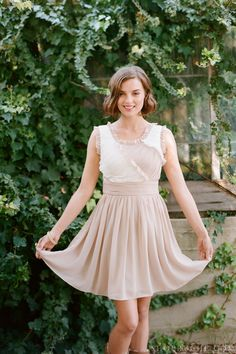 A neutral-colored bridesmaids dress can still be fun with added pleats and ruffles! #bridal #ruche #shopruche