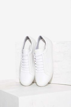 What can't you wear this with? The Zoe Sneaker is made in matte white leather and features a minimal lace-up design, and padding at ankles.