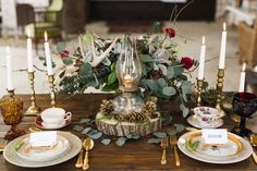 Woodland Wedding Table: Love scouring thrift shops and estate sales? Find mismatched brass candlesticks and darling antique china to complement your fall woodland theme. Arrange deeply hued flowers in vases and stack lanterns on vases to create an unforgettable table.