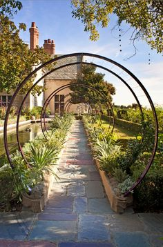round trellis? with climbing flowering vines. Maison de Luxe