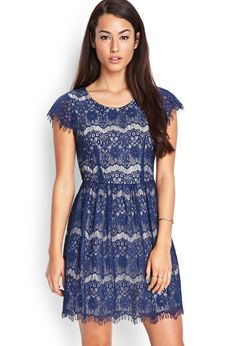 Love 21 - A short sleeved dress featuring an allover eyelash lace pattern. Finished with a concea...