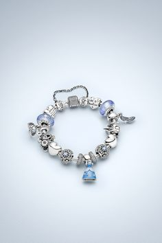 Design your own happily ever after fairy tale bracelet with PANDORA's Cinderella charms. #PANDORAlovesDisney