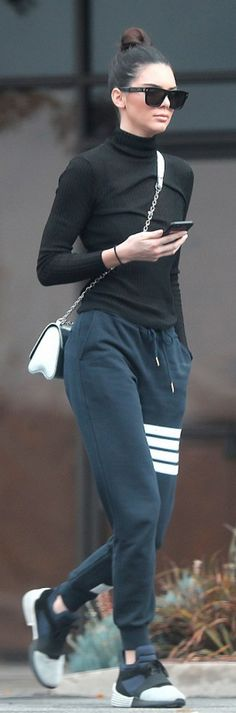 Kendall Jenner in Pants – Thom Browne Purse – Louis Vuitton Shoes – Kendall + Kylie Sunglasses – Givenchy