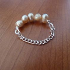 Easily make a ring with just a few small beads, wire and some jewelry chain.