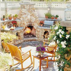 An outdoor wood-burning fireplace area that includes a grill, sink, and two niches for wood storage makes optimal use of limited patio space. Built from stone excavated from the property, the fireplace was carefully constructed to coordinate with the Craftsman bungalow style of the house.