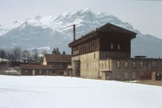 Textile factories in Glarus once employed 6,000 people. Towers used for air drying are one of the most prominent features of the old textile buildings, and the first such tower built in 1865 is still preserved. (Ennenda, 1981)