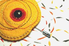 Embroidered orange and yellow felt brooch with black por loopicraft, $18,00