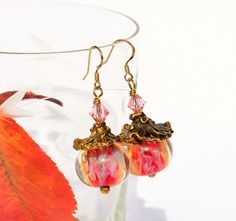 Handmade beaded earrings made from lampwork beads by Laila Strazdina, swarovski crystal and AnnaBronze unique findings. Beautiful pink glass beads and gold vermail earhooks.