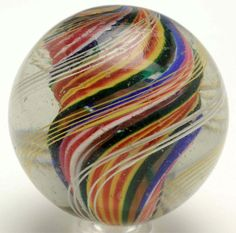 """Large Ribbon Core Swirl Marble  Price Realized $360.00 USD Nice original finish. Deep bands in orange, yellow, pink, blue, and red. Condition (9.3). Size 2 - 1/32"""" Dia"""