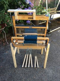 I converted my table weaving loom to a floor standing with pedals. I built the stand and a small attachment for the top to run strings. Made out of 2x2 legs, 1x4 braces on 3 sides, and 1x2 pedals. Metal brackets hold the loom to the legs.  It is designed so the loom can be taken off the stand if I decide I want to do that at some point. It works very well! It will make my weaving so much faster!