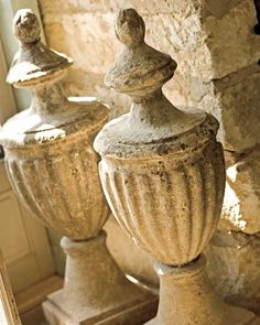 gorgeous stone urn finials- I would love to have these in my garden