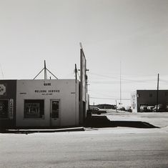 Reminiscent of Ruscha Robert Adams Colorado Springs, Colorado, Gelatin silver print, printed 6 × 6 in × cm Monochrome Photography, Color Photography, Street Photography, Landscape Photography, Contemporary Photography, Night Photography, White Photography, Stephen Shore, Susan Sullivan
