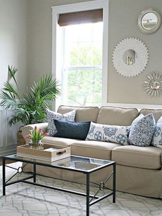 Sarah of Thrifty Decor Chick used this comfortable beige sofa as the anchor of her quickie living room makeover. (Everything else is just clever rearrangement!) The sofa's cotton slipcover and rolled arms lend a comfortable cottage feel to the cream-and-blue space.