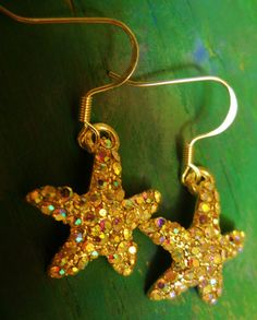 Sparkle and radiant Starfish dangle earrings by AhrensGallery