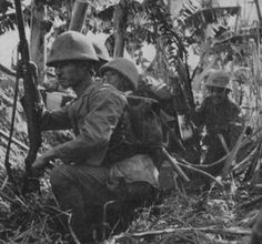Japanese marines wait for nightfall to commence an attack on American positions, Guadalcanal