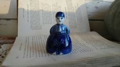 Check out this item in my Etsy shop https://www.etsy.com/listing/222173085/vintage-delft-blue-bell-figurine-antique
