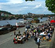 Prague Flea Market, Along the riverbank near Palackeho namesti.  Metro: Karlovo namesti (line B, exit Palackeho namesti).  Trams: 3,7,16,17,21 (Výtoň or Palackeho namesti stops).  Jan-Dec: Every Saturday 09:00-16:00.  The Prague flea market, on the river embankment every Saturday, mainly attracts local Czech people, with a smattering of tourists there for curiosity sake. From the city centre (Old Town and New Town side of the river), it makes for a pleasant stroll along the river.