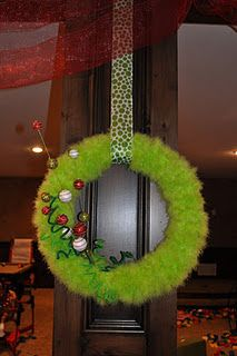 grinch wreath needs ribbon saying either we've been grinched or the real grinch lives here