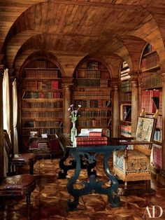 Studio Peregalli transformed a historic villa near Venice. The library features oak paneling and columned arches; the table is 17th-century Tuscan, and the embossed-leather chairs are Louis XVI | archdigest.com