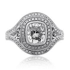 Reis-Nichols Jewelers : Diamond Engagement Ring : in platinum - Just no! This looks like a football ring or a cocktail ring TOO MUCH. Money clearly does not buy taste.