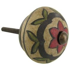 """Add a decorative touch to doors, cabinets, dressers and more with this vintage Antique Red, Black & Green Floral Ceramic Knob. This gorgeous round knob features green leaves, a black scallop design, and a red flower, all against a distressed tan knob. Antique brass hardware adds the perfect rustic touch.    Dimensions:      Knob Width: 1 1/2""""    Projection: 3/4""""    Screw Length: 1 1/4"""""""
