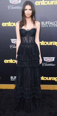 Emily Ratajkowski in a black tiered evening gown.