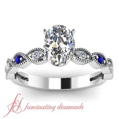 .60 Ct Oval Shaped Diamond Blue Sapphire Archetypal Engagement Ring GIA White Gold