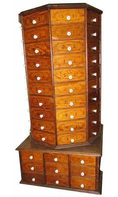 Hardware Store Revolving Bolt Cabinet on original base.     ...Sold for $1650