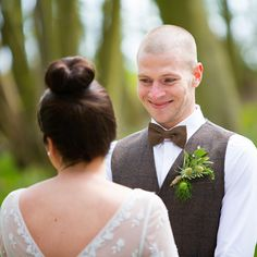 The groom only has eyes for his bride during their ceremony in the bluebell woods at Jimmy's Farm, Suffolk. www.headoverheelsphotography.co.uk