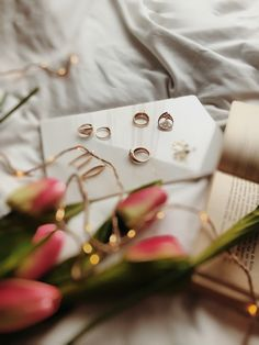 Gold rings / jewellery / gold jewelry / on the bed / product photography