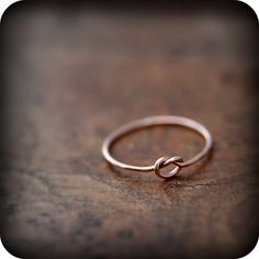 Knot ring  solid 14K rose gold ring by junedesigns on Etsy, $82.00. Wedding ring for traveling :)
