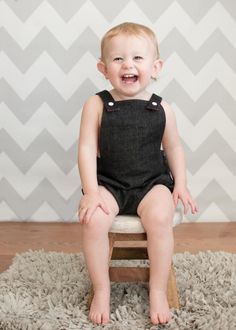 Dark denim baby romper with lined front bodice. The bodice and straps are lined in red. The romper has elasticated back with snaps attached to the bib front by Kam snaps. This style does not carry snaps at the crotch. This toddler romper is available in sizes from newborn to age 3. This could be a perfect costume for a mini photo shoot, a cake smash, Valentines Day or a first birthday party. Other Information: Machine Wash Gentle Cold with like Colors, Nonchlorine Bleach, Tumble Dry Low…