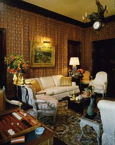 """Paley apartment at 820 Fifth: Billy Baldwin recreated the sumptuous room he designed for the Paleys' pied-à-terre at the St. Regis: walls curtained in red-brown print, French furniture artfully scattered on a needlepoint carpet stitched with blackamoor heads, and, above the whole, a Venetian chandelier centered by a clock."""" In the Paleys' Fifth Avenue apartment, those sumptuous curtained walls became a backdrop for Gauguin's Washerwomen."""